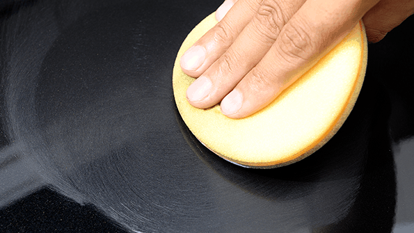 hand waxing black car