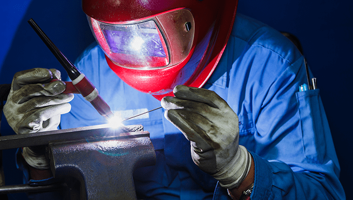 man using tig welder